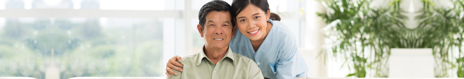 young caregiver with her senior patient